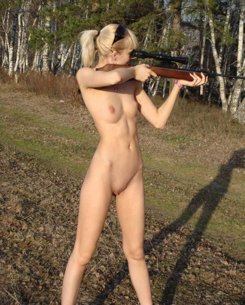 sexy woman nude with guns